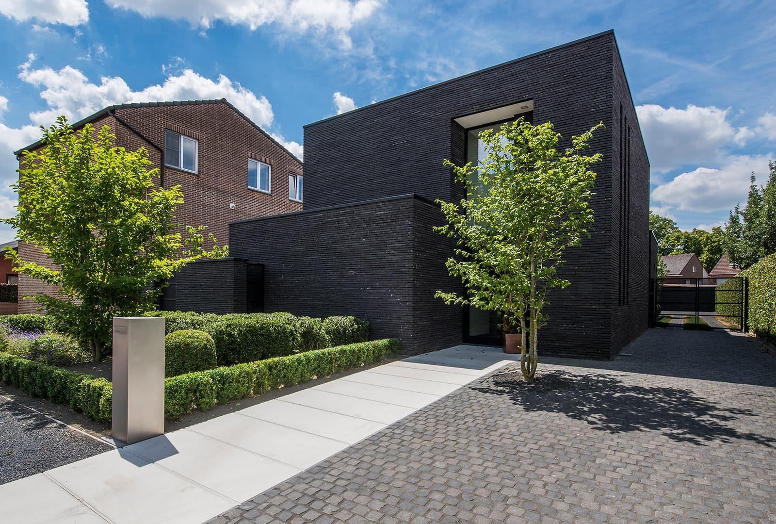 Moderne tuin met overloopvijver wim verrezen for Voortuin modern